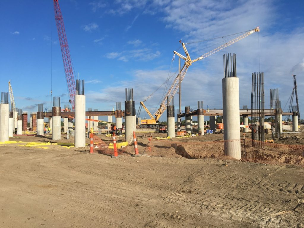 Piles being driven at the construction site via flymsy.com's October Board Update.